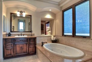Mediterranean Full Bathroom with stone tile floors, Limestone, drop in bathtub, Casement, Limestone counters, Standard height
