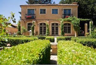Mediterranean Landscape/Yard with Transom window, Fire pit, Arbor, Pathway, Casement, Deck Railing, Trellis, French doors