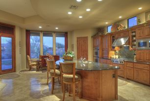 Traditional Great Room with High ceiling, Undermount sink, built-in microwave, Kitchen island, Vinyl floors, Transom window