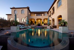Mediterranean Swimming Pool with Arched window, exterior stone floors, Transom window, Fence, Pool with hot tub, French doors