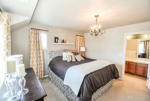Traditional Guest Bedroom with Built-in bookshelf, Carpet, Chandelier