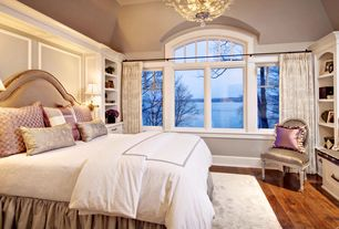 Traditional Master Bedroom with Built-in bookshelf, High ceiling, Paint, specialty window, Hardwood floors, Chandelier