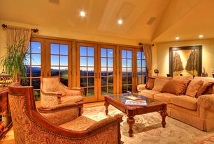 Traditional Living Room with High ceiling, Hardwood floors, French doors