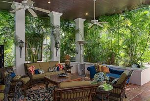 Tropical Porch with exterior tile floors, Raised beds, exterior terracotta tile floors