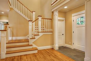Traditional Entryway with Cathedral ceiling, Wood stair steps, Paint 1, specialty door, Glass panel door, Paint, Columns