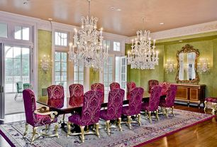 Traditional Dining Room with Standard height, Wall sconce, Glass panel door, Crown molding, Columns, Transom window