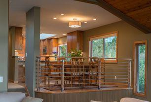 Contemporary Dining Room with Built-in bookshelf, Sunken living room, Hardwood floors, Chandelier, Columns