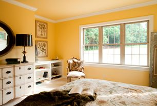 Traditional Master Bedroom with double-hung window, Crown molding, Standard height, Carpet, Built-in bookshelf