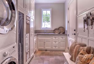Traditional Mud Room with specialty door, limestone tile floors, Casement, Wainscotting, Built-in bookshelf, Standard height