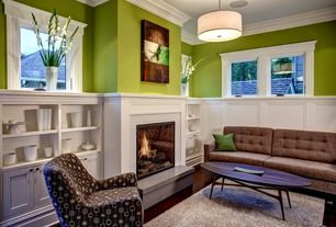 Contemporary Living Room with Hardwood floors, Built-in bookshelf, Tufted loveseat, Artwork, Wainscotting, Crown molding