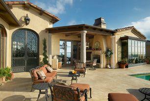 Mediterranean Patio with Glass panel door, Raised beds, exterior tile floors