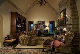 Traditional Living Room with Wall sconce, can lights, Crown molding, Brick floors, French doors, Chandelier, Fireplace