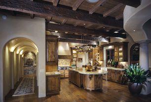 Mediterranean Kitchen with U-shaped, Columns, Farmhouse sink, Bay window, Custom hood, Stone Tile, Raised panel, Exposed beam