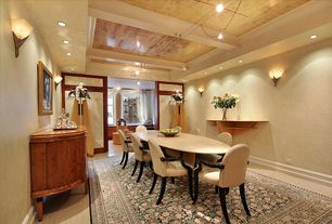 Contemporary Dining Room with Exposed beam, Pendant light, Built-in bookshelf, High ceiling, Laminate floors, can lights