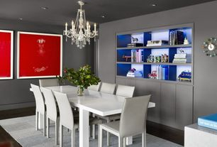 Contemporary Dining Room with Concrete floors, Built-in bookshelf, Chandelier