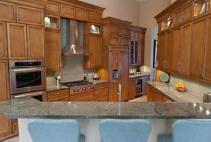 Traditional Kitchen with Built In Panel Ready Refrigerator, Wall Hood, dishwasher, double wall oven, Kitchen peninsula