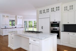 Traditional Kitchen with Glass panel, Natural reflections cinnamon maple solid hardwood flooring, Simple marble counters
