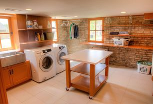 Eclectic Laundry Room with Crown molding, sandstone tile floors, can lights, stone tile floors, drop-in sink, laundry sink