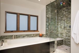 Contemporary Master Bathroom with can lights, Rain shower, Casement, drop in bathtub, Standard height, stone tile floors