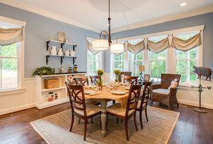 Country Dining Room with Crown molding, Hardwood floors, Built-in bookshelf, Chandelier