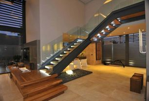 Contemporary Staircase with Metal staircase, High ceiling, Hardwood floors