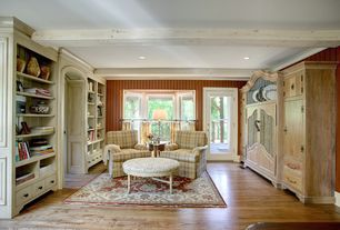Country Living Room with Built-in bookshelf, Hardwood floors, Standard height, Exposed beam, Crown molding, French doors