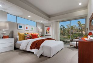 Contemporary Master Bedroom with can lights, Standard height, sliding glass door, Carpet, picture window