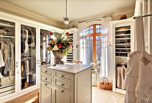 Traditional Closet with Arched window, Pendant light, Hardwood floors, Wall sconce, Crown molding, Built-in bookshelf