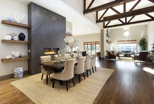 Contemporary Great Room with Built-in bookshelf, Hardwood floors, Exposed beam, Transom window, Tufted back dining chair