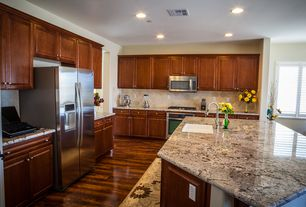 Traditional Kitchen with Kitchen island, electric cooktop, Standard height, Flush, built-in microwave, Stone Tile, wall oven