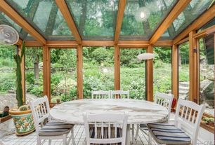 Country Dining Room with can lights, Exposed beam, Skylight, Standard height, Casement, picture window, limestone tile floors