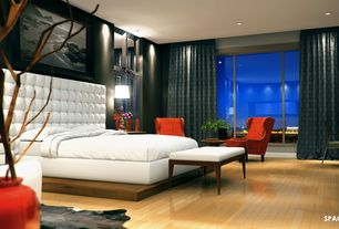Contemporary Master Bedroom with Laminate floors, Built-in bookshelf, can lights, Standard height, sliding glass door