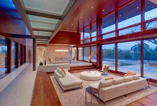 Contemporary Great Room with Hardwood floors, Exposed beam, Columns, Chandelier, Sunken living room, Box ceiling