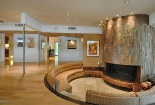 Modern Living Room with Caramel engineered hickory hardwood flooring, Exposed beam, Carpet, stone fireplace, Columns