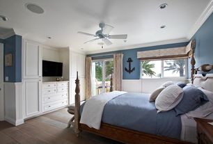Cottage Master Bedroom with Crown molding, Built-in bookshelf, Wide plank floors, Ceiling fan, Nautical, Hardwood floors