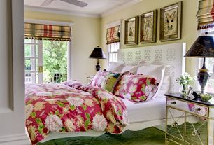 Traditional Master Bedroom with Ceiling fan, double-hung window, sliding glass door, Standard height, Crown molding, Carpet