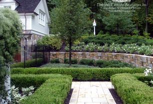 Traditional Landscape/Yard with Fence, six panel door, double-hung window, Raised beds, Pathway, exterior stone floors