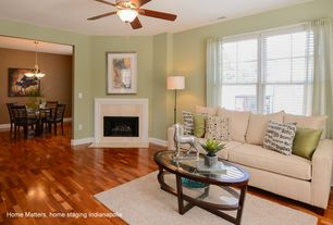 Traditional Living Room with Hardwood floors, stone fireplace, Ceiling fan, Bernhardt Zola Coffee Table