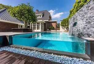 Contemporary Swimming Pool with Infinity pool, Glass panel door, French doors, Raised beds, Fountain, Fence