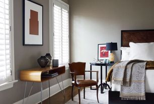 Traditional Master Bedroom with Hardwood floors, Art desk, Crown molding, Mid-century modern end table, Paint