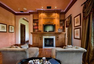 Traditional Living Room with Cement fireplace, Hardwood floors, Crown molding, Built-in bookshelf