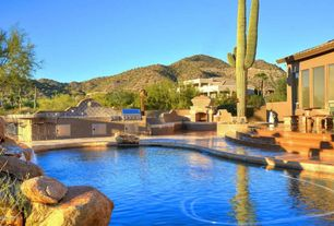 Mediterranean Swimming Pool with Outdoor kitchen, outdoor pizza oven, exterior stone floors