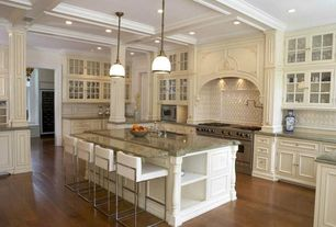 Traditional Kitchen with Ms International Costa Esmeralda, built-in microwave, Breakfast bar, can lights, Flat panel cabinets