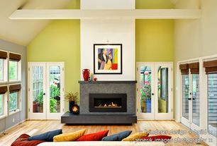 Modern Living Room with Hardwood floors, stone fireplace, Casement, French doors, High ceiling, Fireplace, Exposed beam