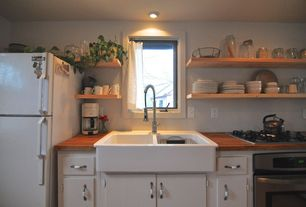 Country Kitchen with Floating shelves, wall oven, flush light, One-wall, Wood counters, Casement, Farmhouse sink