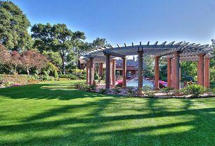 Traditional Landscape/Yard with Trellis, Pathway, exterior brick floors, Lap pool, Gazebo, Fountain
