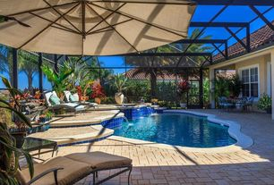 Mediterranean Swimming Pool with French doors, Skylight, exterior stone floors, Fence, Pool with hot tub, Indoor pool