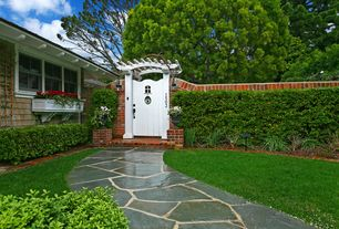 Traditional Landscape/Yard with exterior awning, Gate, exterior stone floors, Fence, Pathway, Raised beds