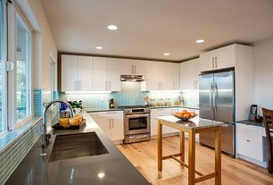 Traditional Kitchen with full backsplash, Kitchen island, Multiple Refrigerators, Large Ceramic Tile, Wall Hood, Flush