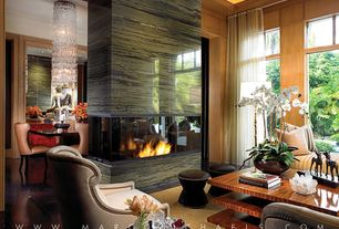 Contemporary Living Room with Concrete floors, Fireplace, picture window, Standard height, insert fireplace